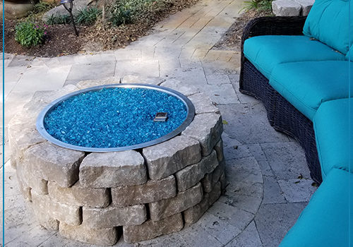 Backyard Fire Pit Spaces by Lanai Outdoor Kitchens in Largo Florida